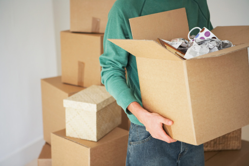 Maryland Tenant Carrying Moving Box into New Rental Property