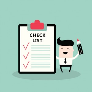 Happy businessman with checklist Successful business concept